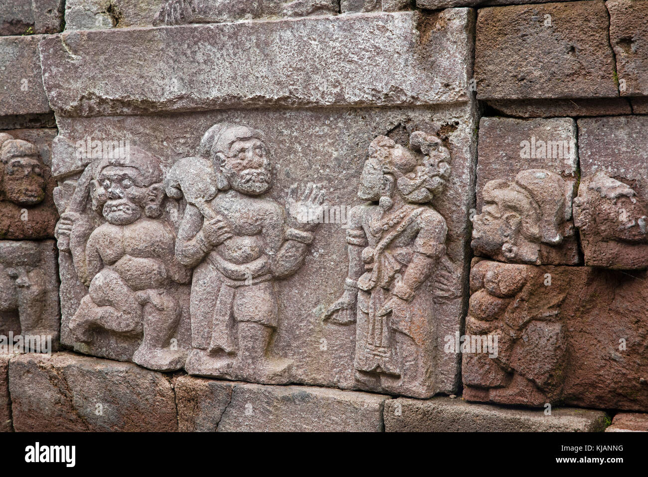 Relief on stone wall at Candi Sukuh, 15th-century Javanese Hindu temple on the slopes of Mount Lawu / Gunung Lawu, - Stock Image