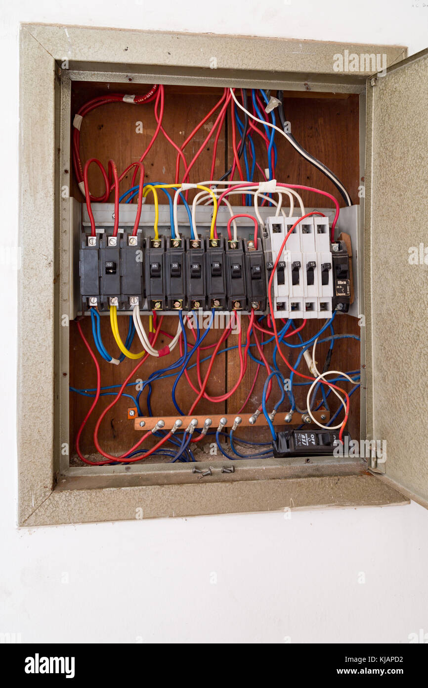 Old circuit breaker switch, cables and wires on panel is seen inside ...
