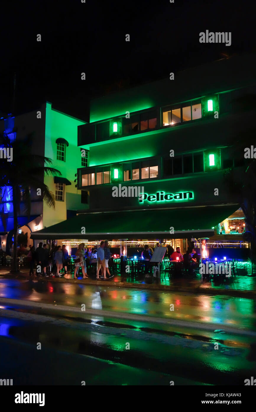 The Pelican Hotel lit up at night in neon. South Beach Art Deco District Miami Florida USA - Stock Image