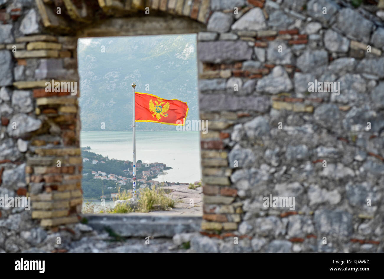 Montenegrin flag, viewed from the Fortifications of Kotor Stock Photo