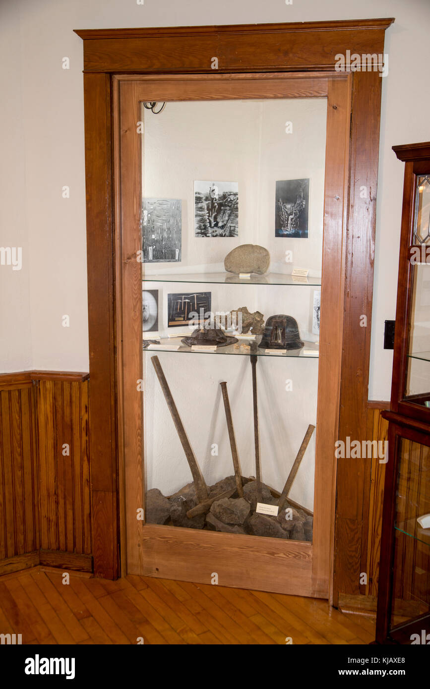 Eagle River Michigan. Eagle River Museum. Exhibit showing the tools and hats used for mining in the 1800s. & Eagle River Michigan. Eagle River Museum. Exhibit showing the Stock ...