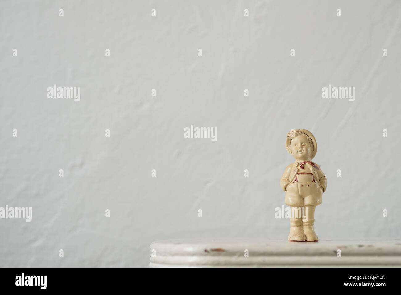 Little Ceramic  Boy Statue - Stock Image