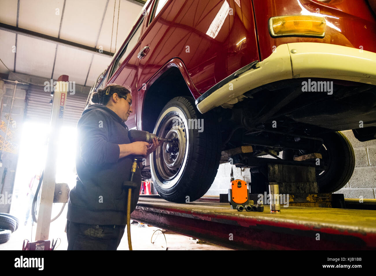 stock german workshops photo inspection technical repair vw association garages in dawtff mechanic a of checking the volkswagen shop beetle technics