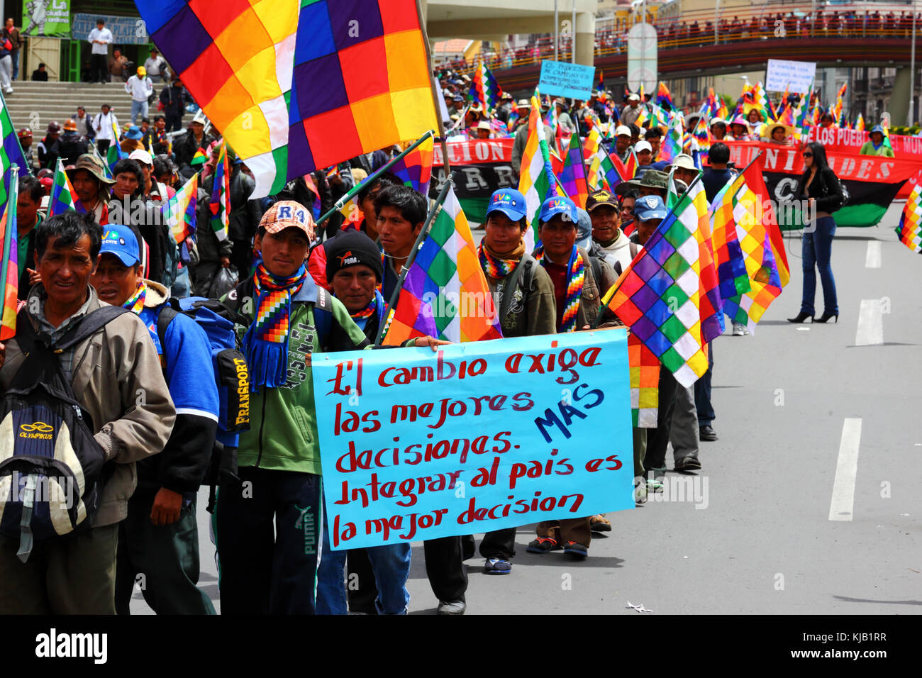 Members of various Social Movements take part in a pro government march supporting plans to build a road through - Stock Image
