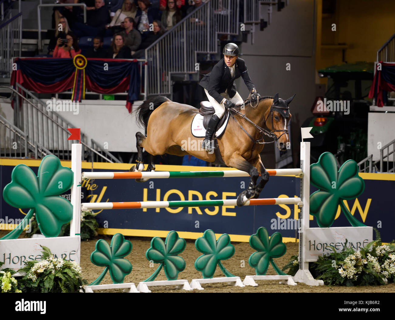 Sharn Wordley New Zealand riding Barnetta to third place in the Longines FEI World Cup Show Jumping competition - Stock Image