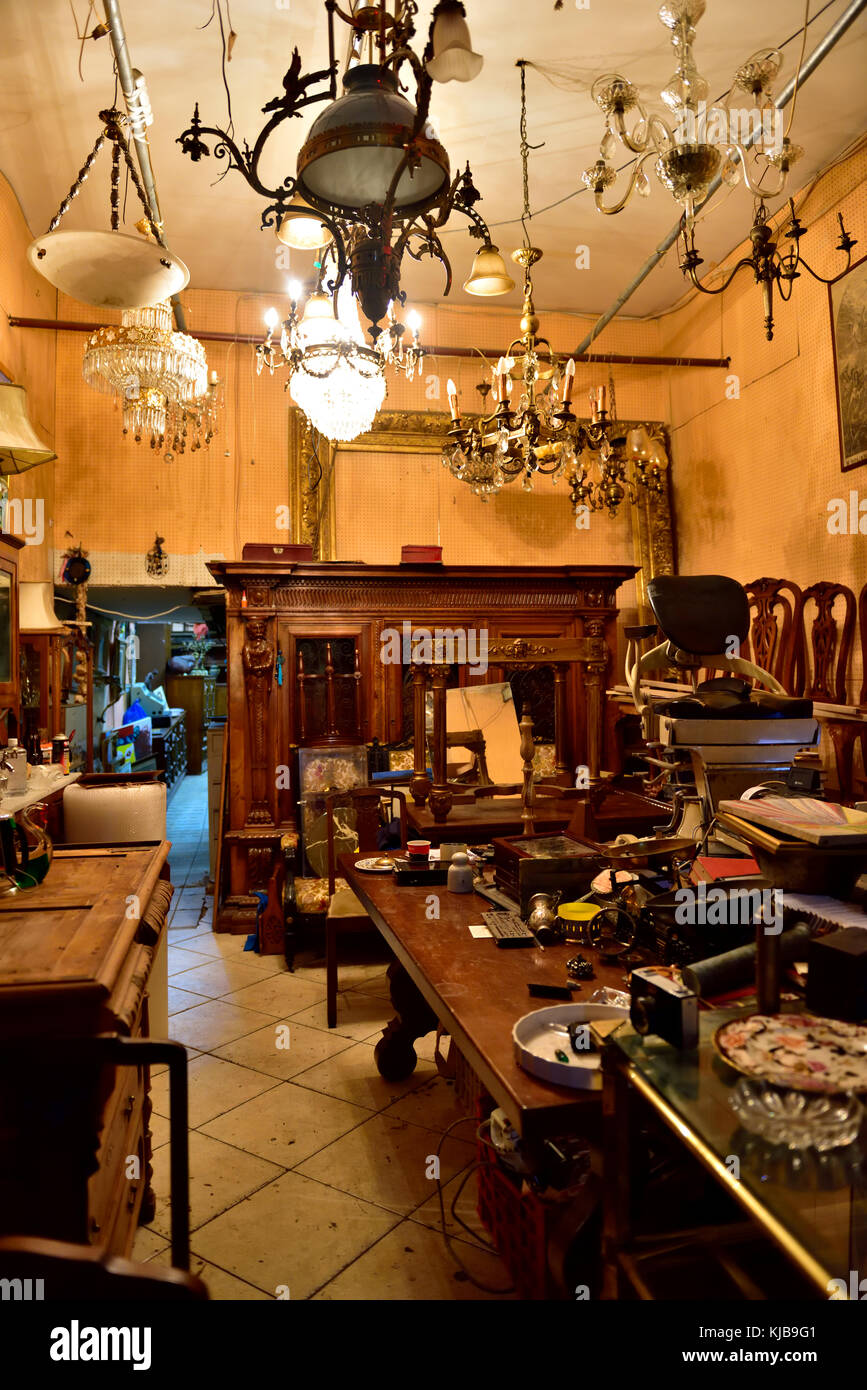 Inside antiques store with furniture, bric-a-brac, collectables off Ermou Street Monastiriaki area of central Athens, - Stock Image