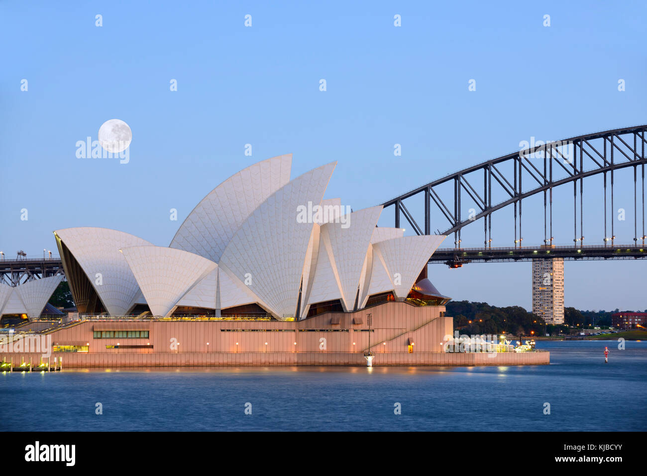 Image of the full super Moon shining right before sunrise over the Sydney Opera House in Sydney, Australia as it Stock Photo