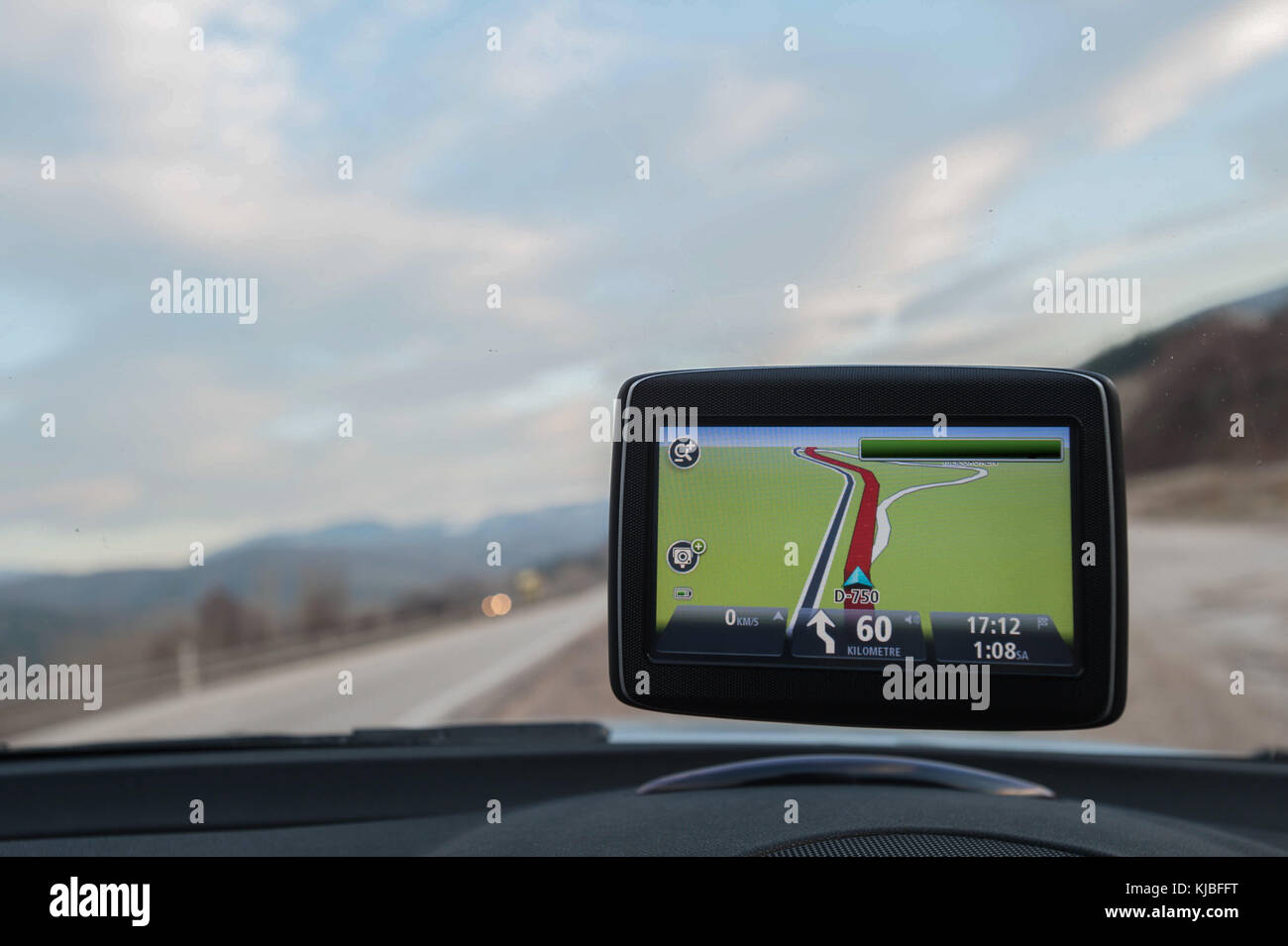 Display of a car navigation system while on the road Stock Photo