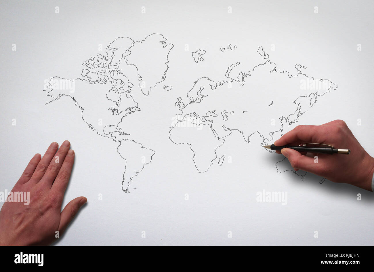 Hands drawing world map outline world map on the old paper texture background hands