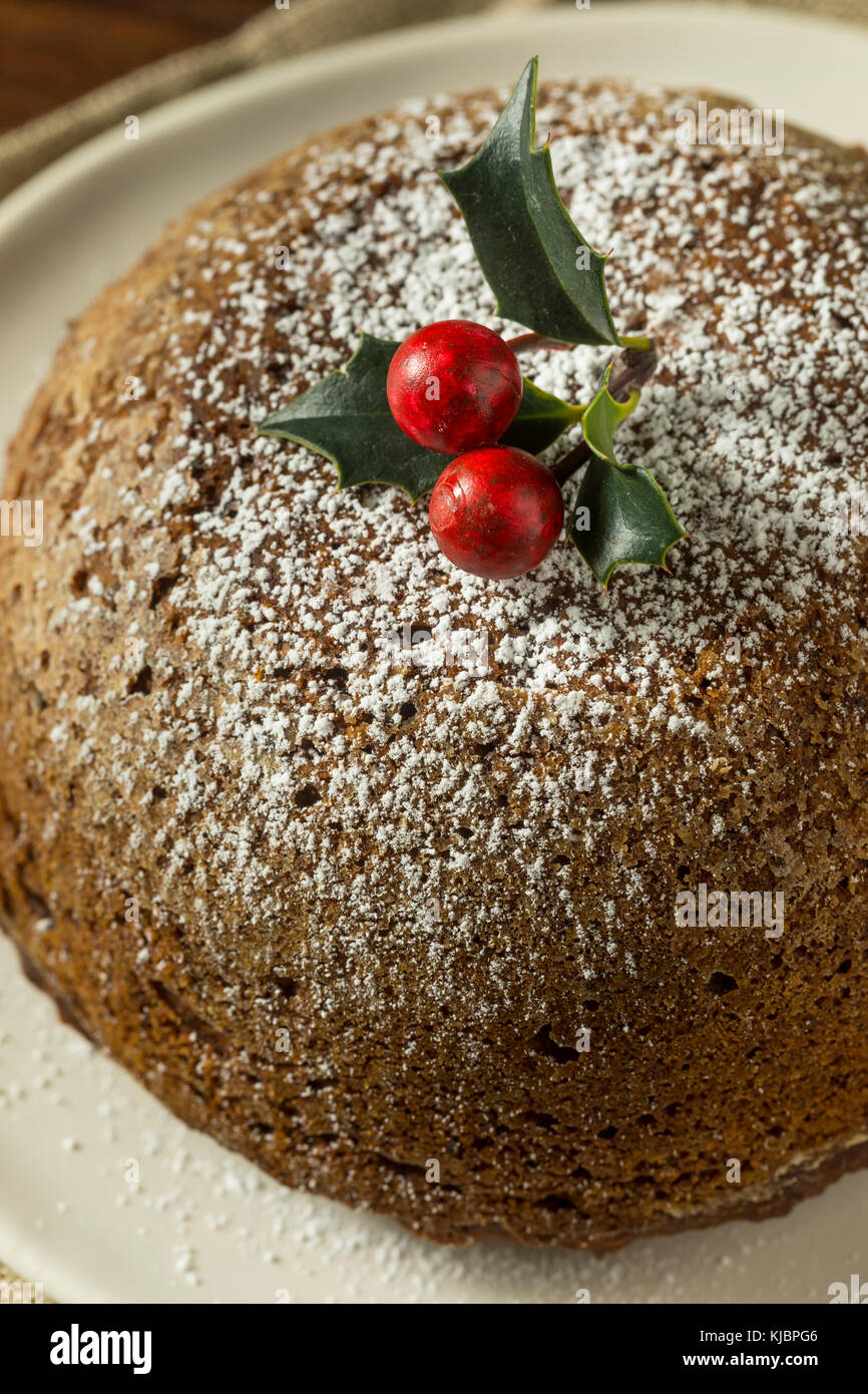 Sweet Homemade Christmas Figgy Pudding with Powdered Sugar - Stock Image