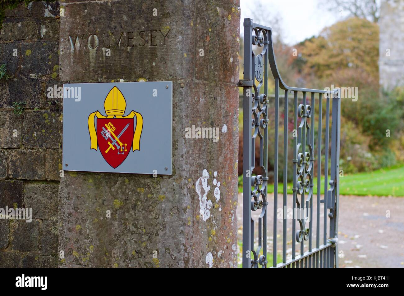 Crest of Wolvesey Castle next to open gates, Winchester, UK Stock Photo