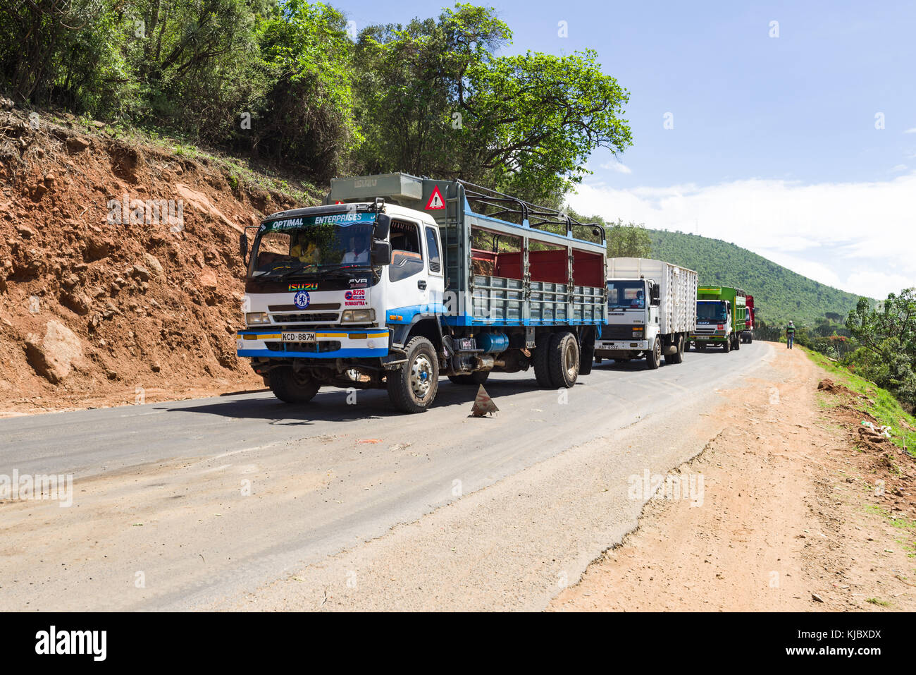 A line of trucks stopped on the road due to an accident further ahead, Rift Valley road, Kenya, East Africa Stock Photo