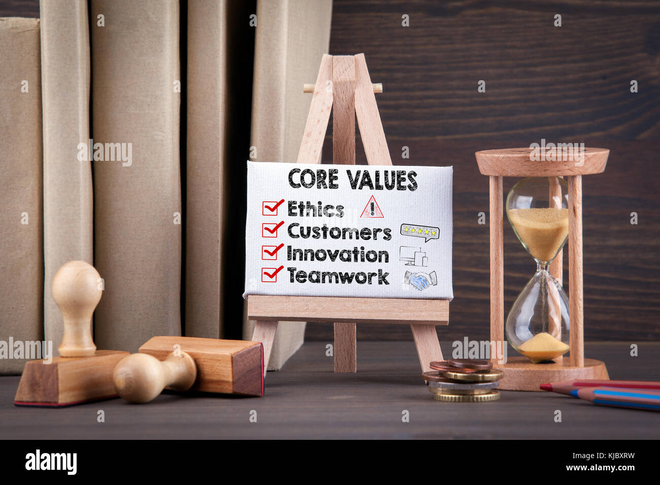 Core Values concept with icons. Sandglass, hourglass or egg timer on wooden table  - Stock Image