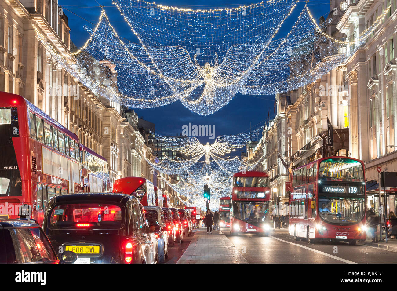 Christmas lights at dusk in Regent Street, Soho, City of Westminster, Greater London, England, United Kingdom - Stock Image