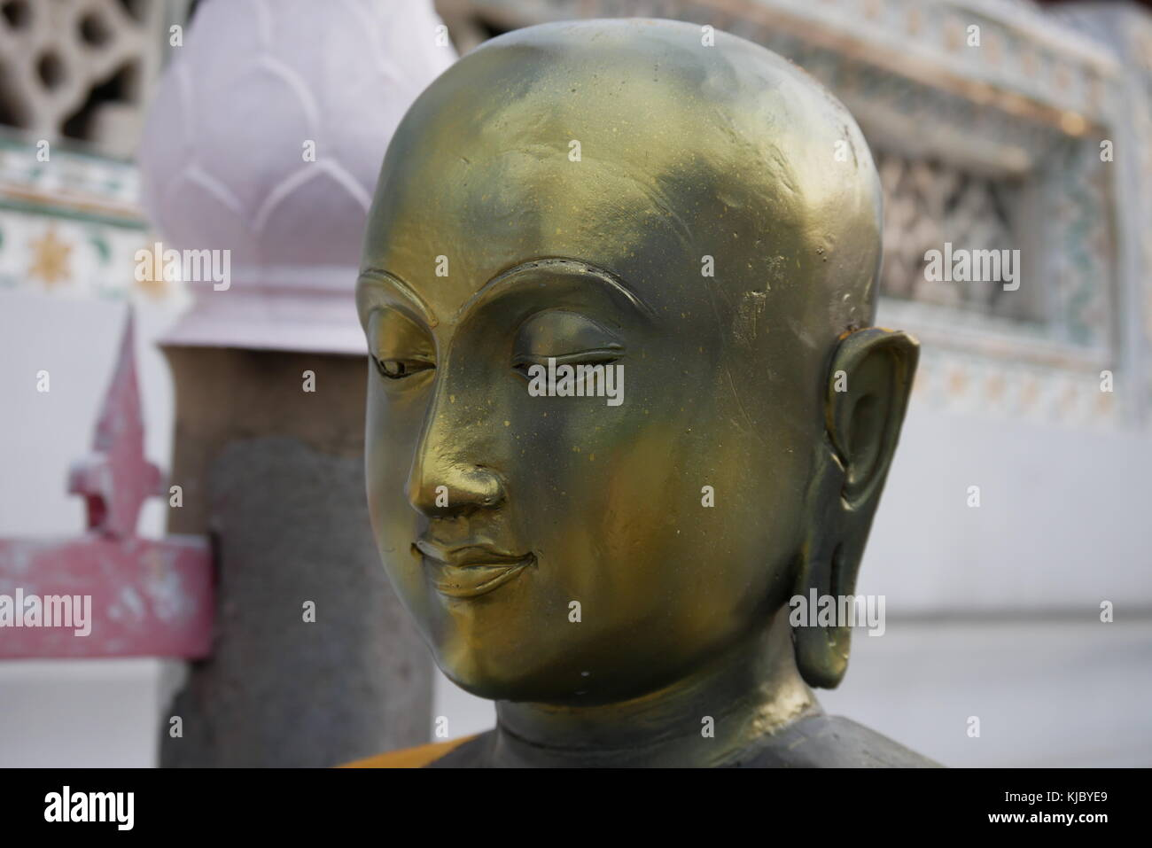 A golden statue of Buddha praying in Wat Arun, the Temple of Dawn, in Bangkok, Thailand. - Stock Image