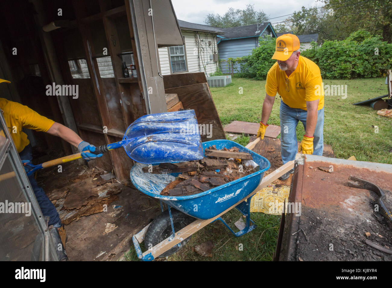 Houston, Texas - Oklahoma volunteers from the Southern Baptist Convention clean debris from a home that was flooded - Stock Image