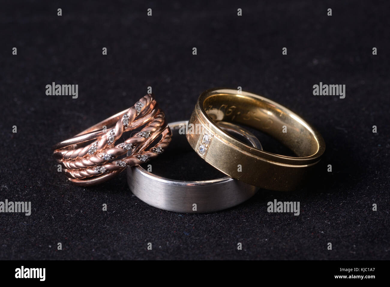 selection of rings in rose, white and yellow gold - Stock Image