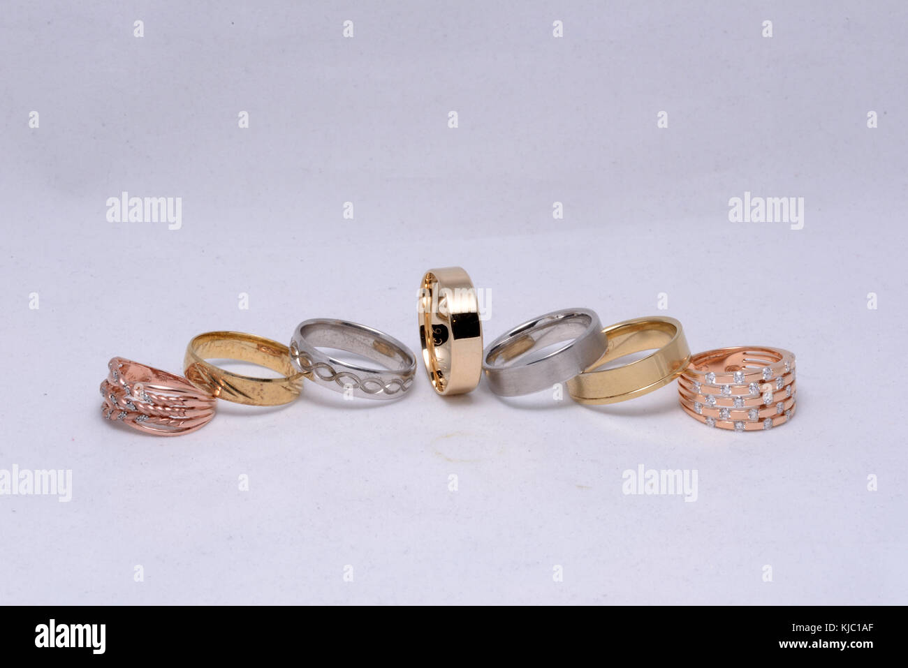 A display of gold and silver rings - Stock Image
