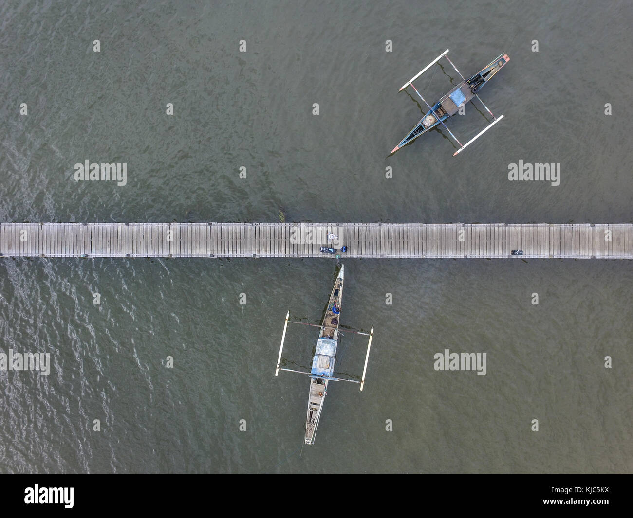 Traditional fishing boat anchored in a harbor bridge in gulf of Bone - South Sulawesi  - Indonesia - Stock Image