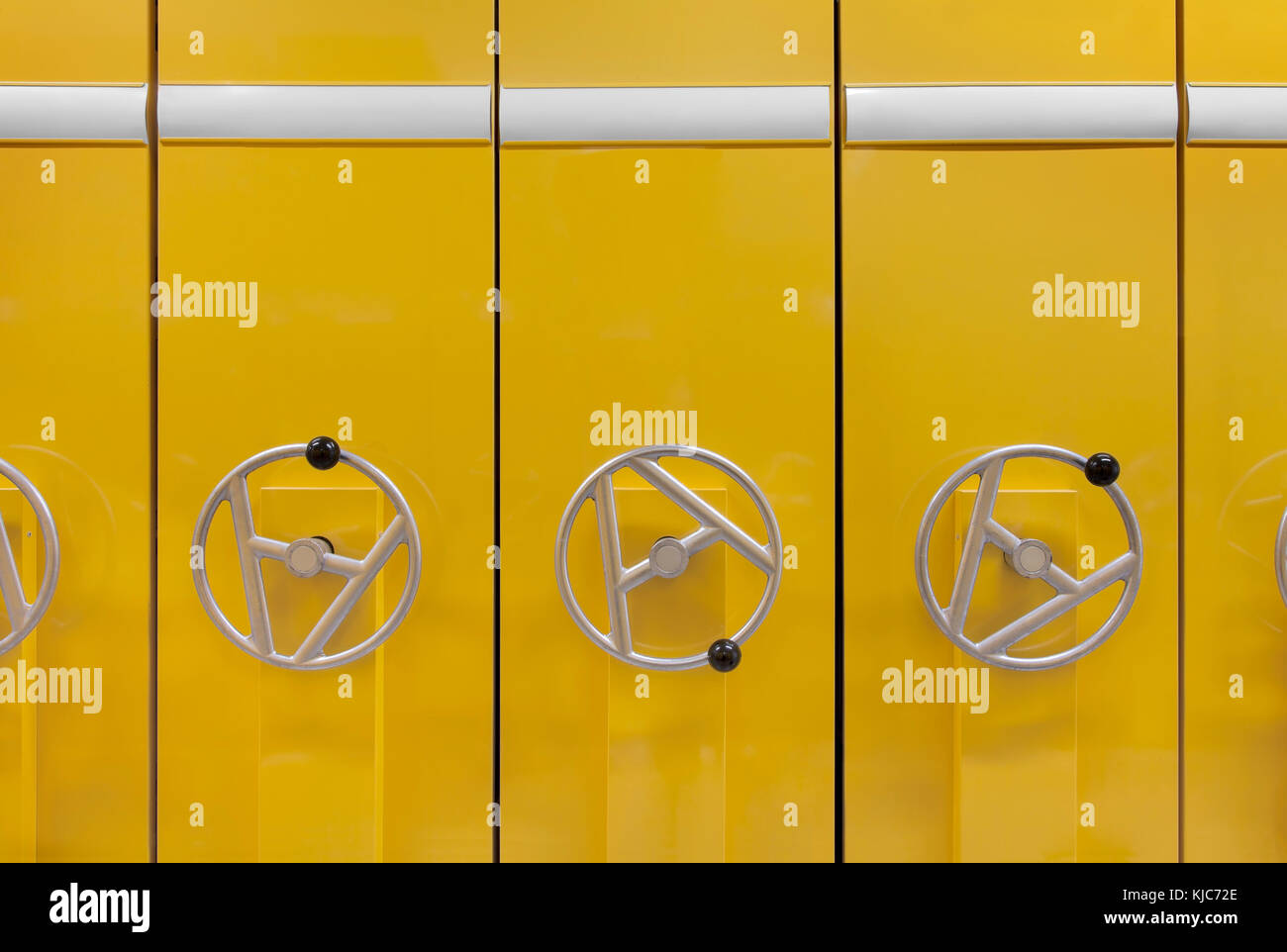 Front view of  files cabinet  in yellow color. White labels and copy space Stock Photo