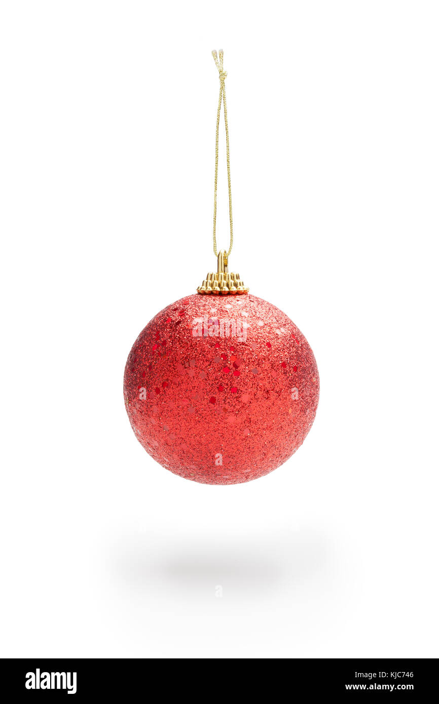 Sparkling red color christmas ball hanging from cord. Soft shadow against white background. Clipping path - Stock Image