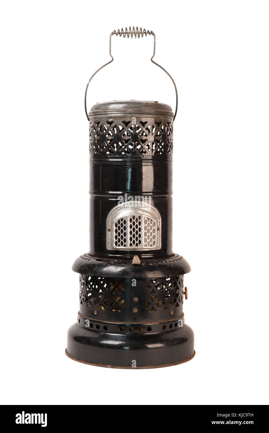 Old black kerosene heater isolated on white - Stock Image