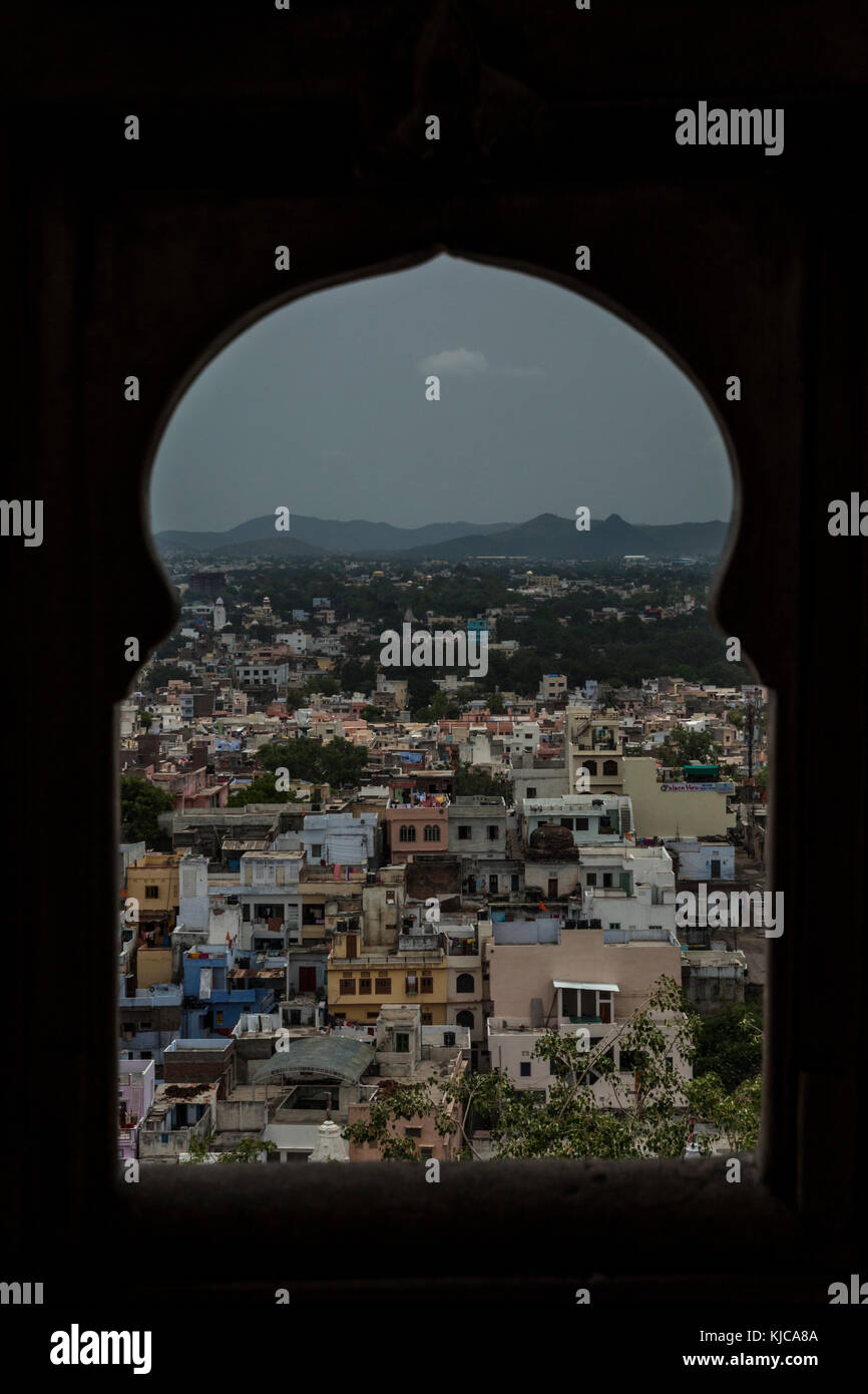 A view of Udaipur through a temple window. - Stock Image