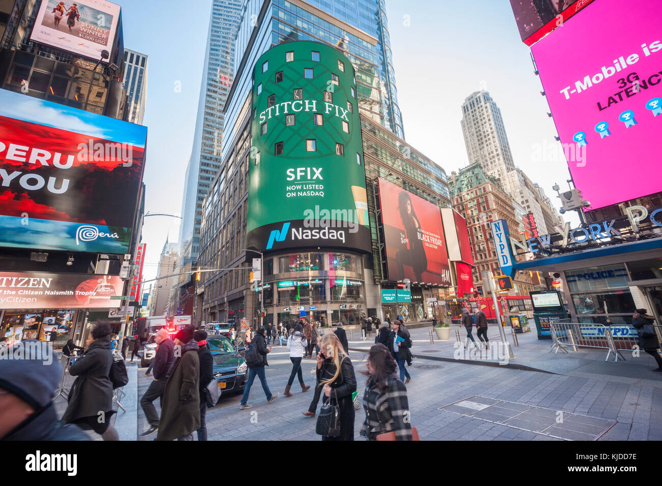 The video screen of the Nasdaq exchange in New York  displays advertising for the first day of sale of the Stitch - Stock Image