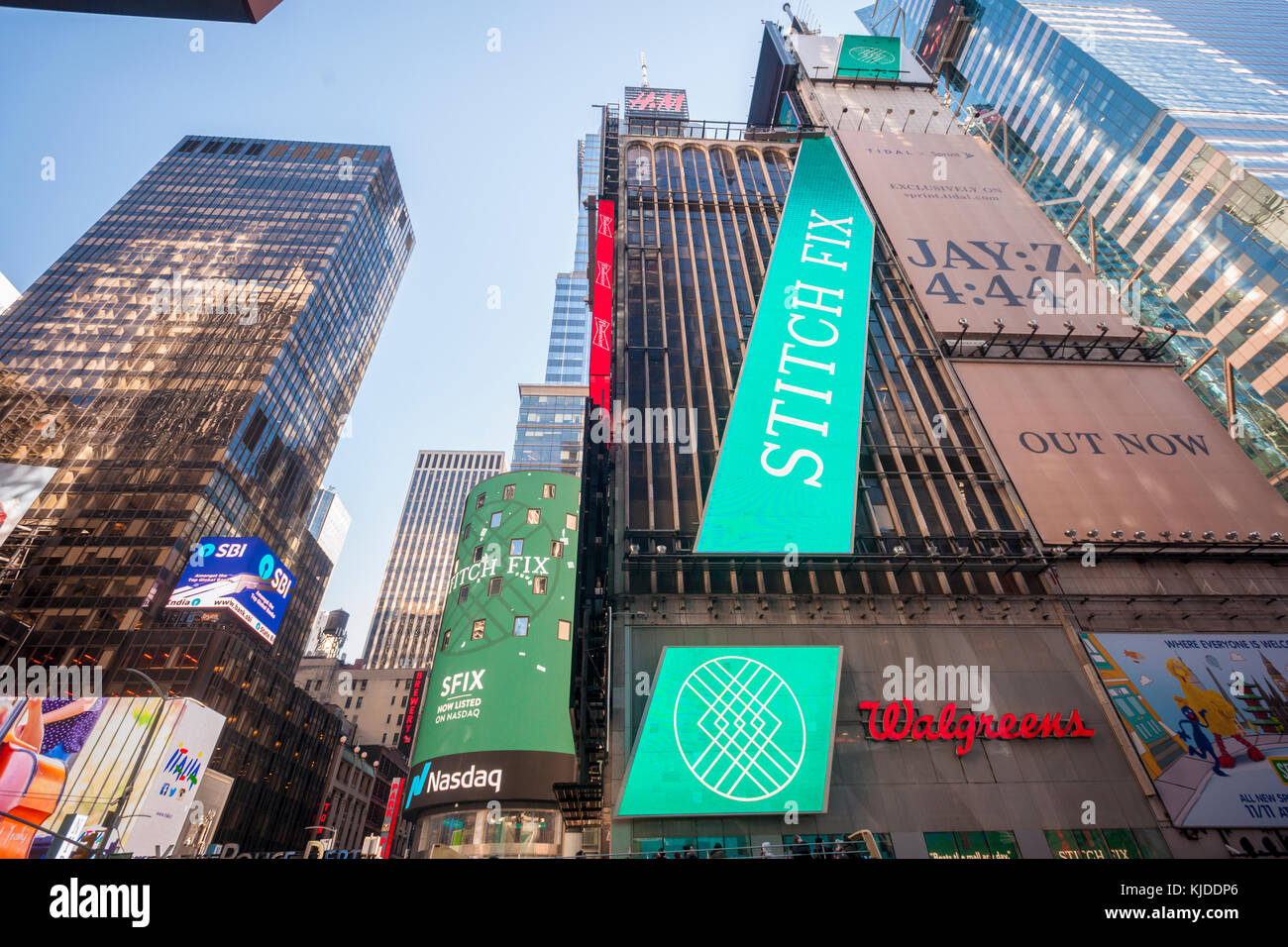 Video screens in Times Square display advertising for the first day of sale of the Stitch Fix initial public offering - Stock Image