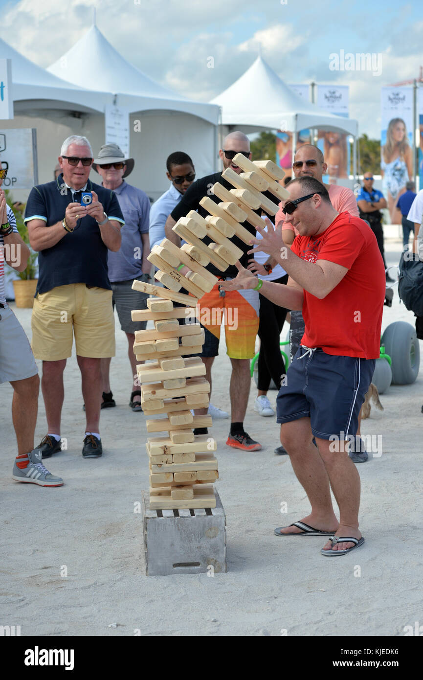 MIAMI, FLORIDA - FEBRUARY 18: Jenga is a game of physical and mental skill created by Leslie Scott, and currently - Stock Image