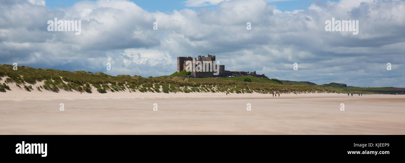 Bamburgh Castle Northumberland England UK with white sandy beach panoramic view - Stock Image