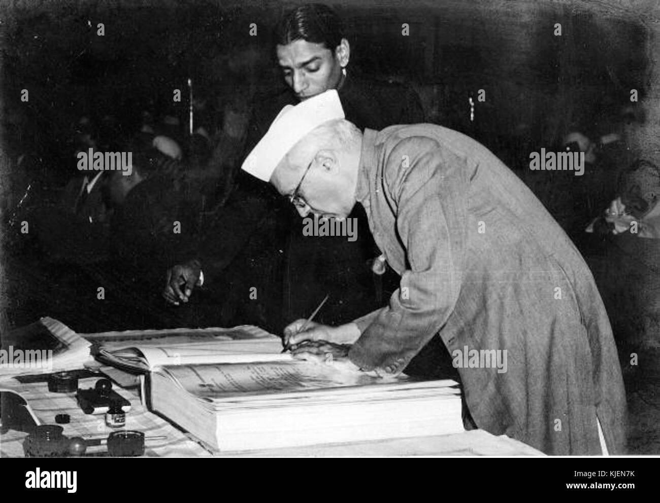 Jawaharlal Nehru signing Indian Constitution Stock Photo