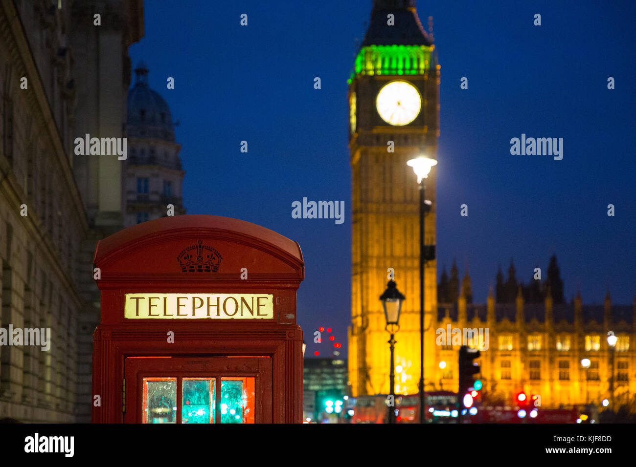 Red London telephone box with Big Ben at night - London, UK - Stock Image