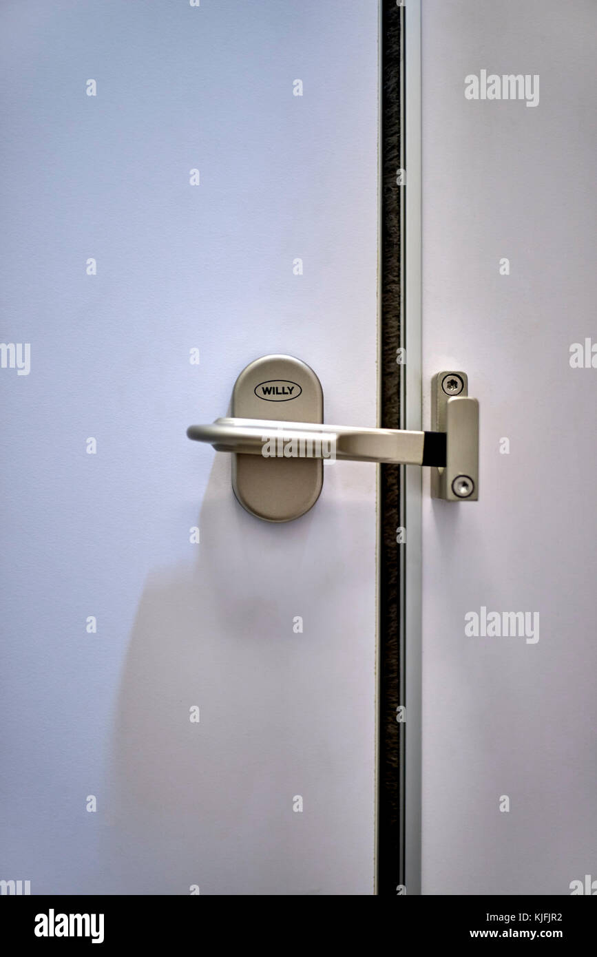 Aptly named and amusing door lock in a Thailand gents WC. - Stock Image