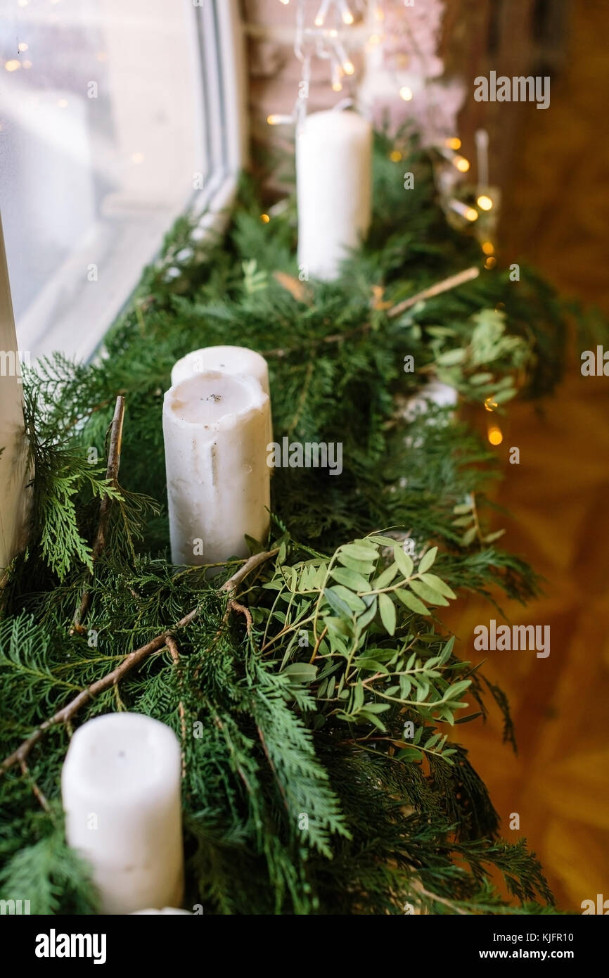 decoration, cosiness, home concept. close up of narrow windowsill lovely decorated with fresh nice smelling bunches - Stock Image