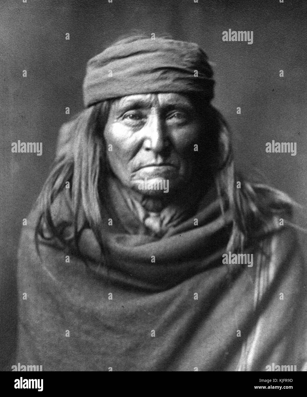 Portrait Of A Mature Native American Man With Long Hair A Head Band