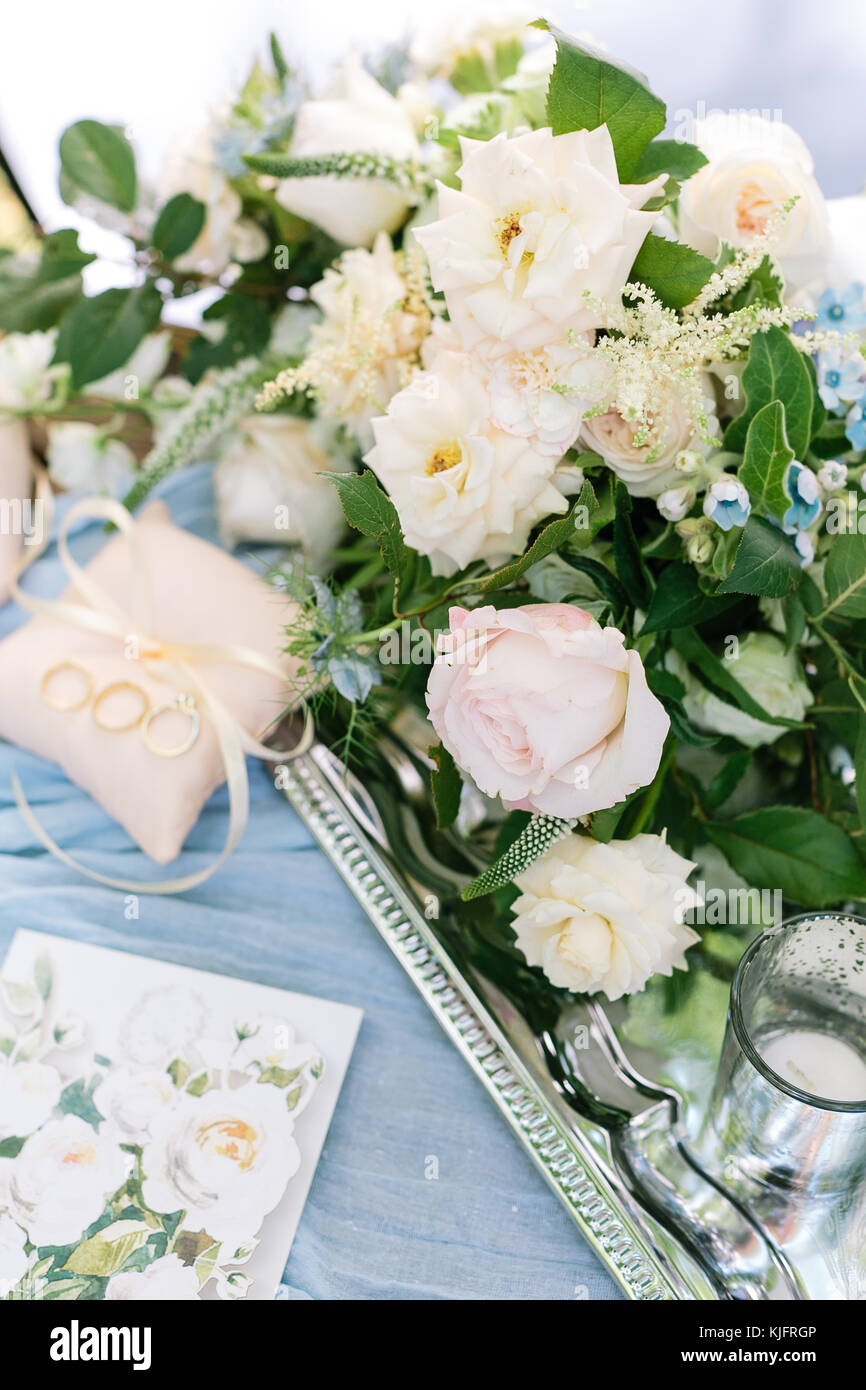 marriage, sentiment, proposal concept. wonderful bridal bouquet of elegant creamy and pink roses decorated with - Stock Image