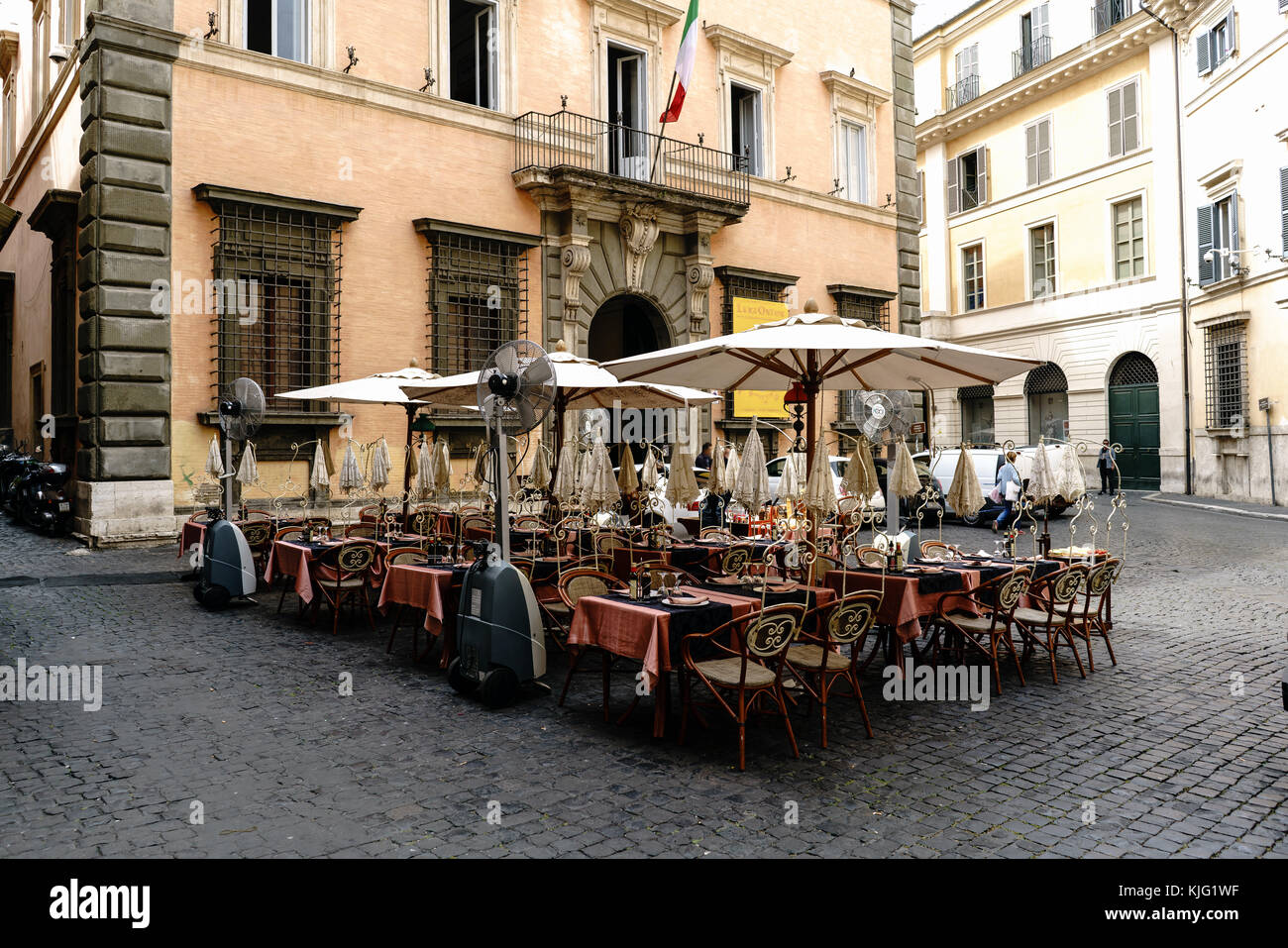 Terrace of a bar on the square called 'Della Academia' (academy) in the center of Rome, Italy. With a typical - Stock Image