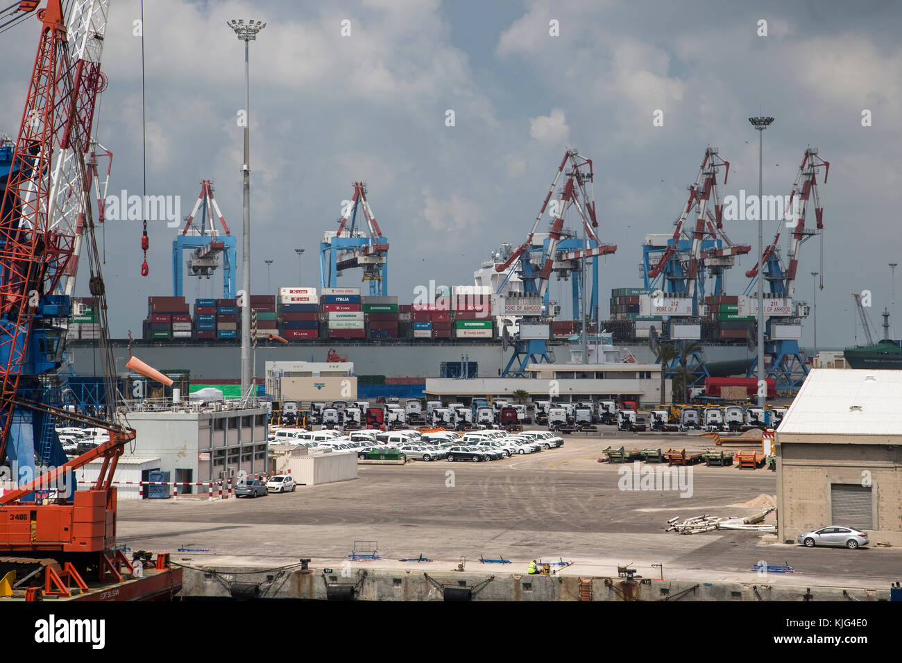 The Port of Ashdod in Israel with several large container handling cranes, vehicles on the dockside and shipping - Stock Image