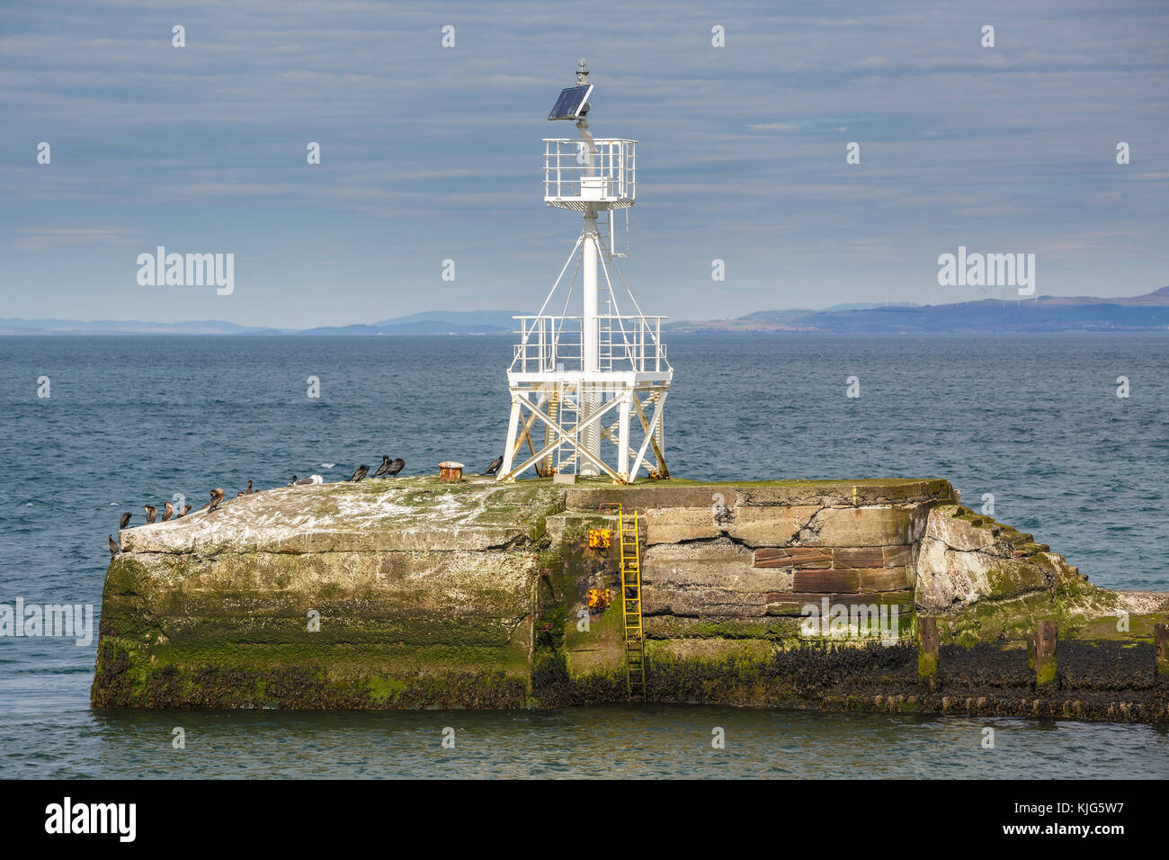 Solar pwered light station at the entrance to Ayr Harbour, Scotland, UK. - Stock Image