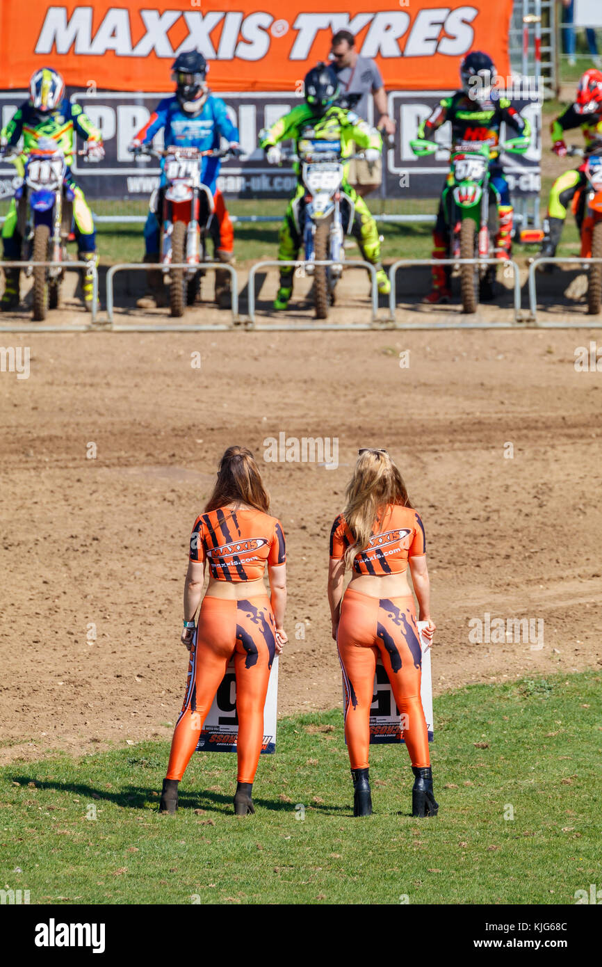 The Maxxis Timing Board Girls prepare for the MX2 Motocross start at the 2017 British Championship meeting at Cadders - Stock Image
