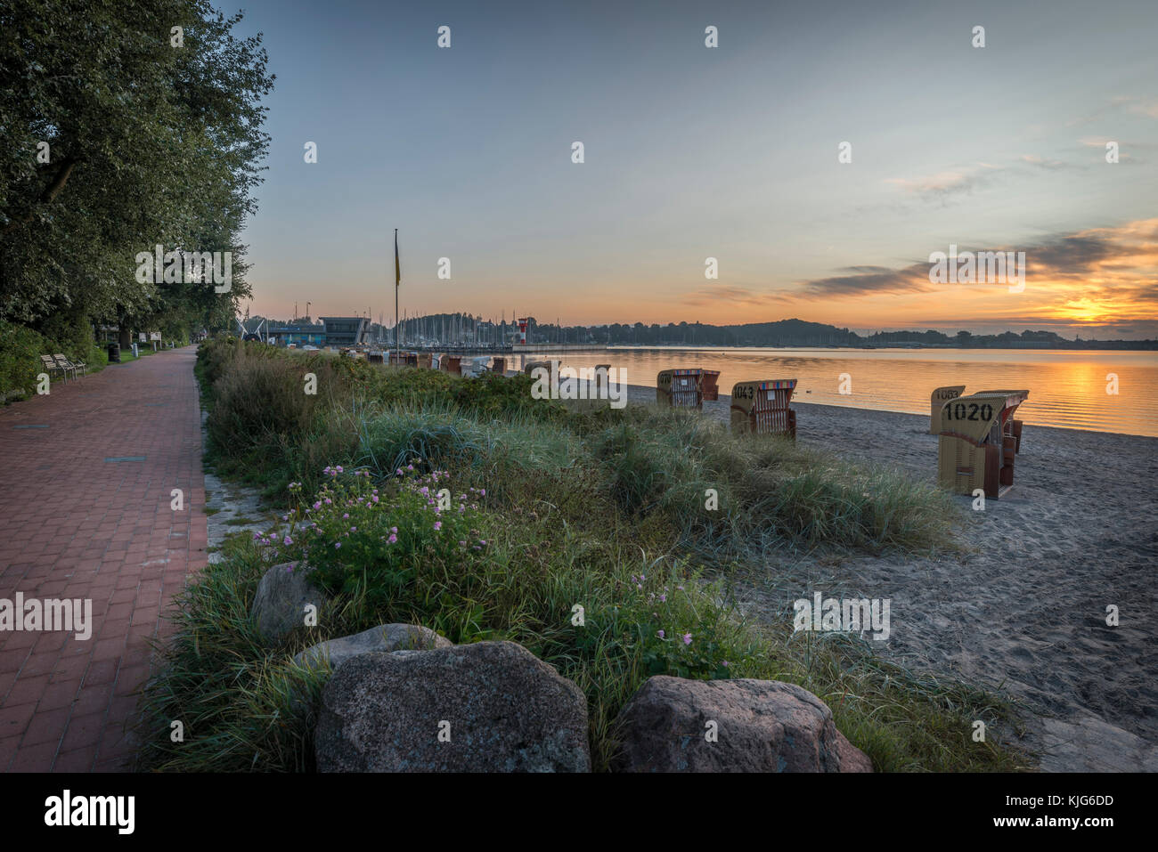 Germany, Eckernfoerde, view to Baltic sea and beach at sunrise Stock Photo