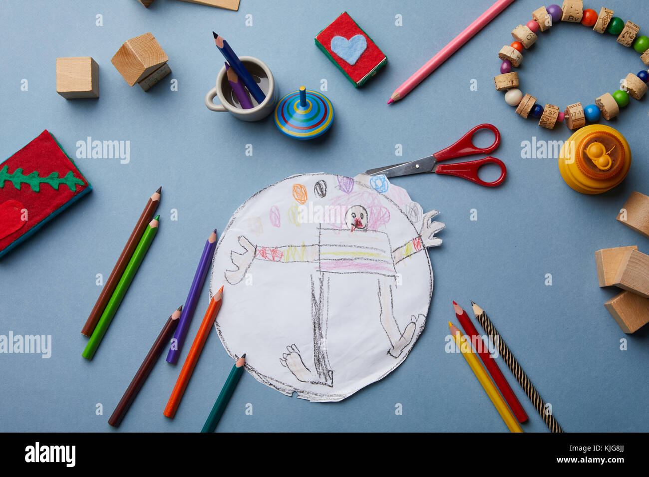 Child's drawing, coloured pencils and accessories - Stock Image