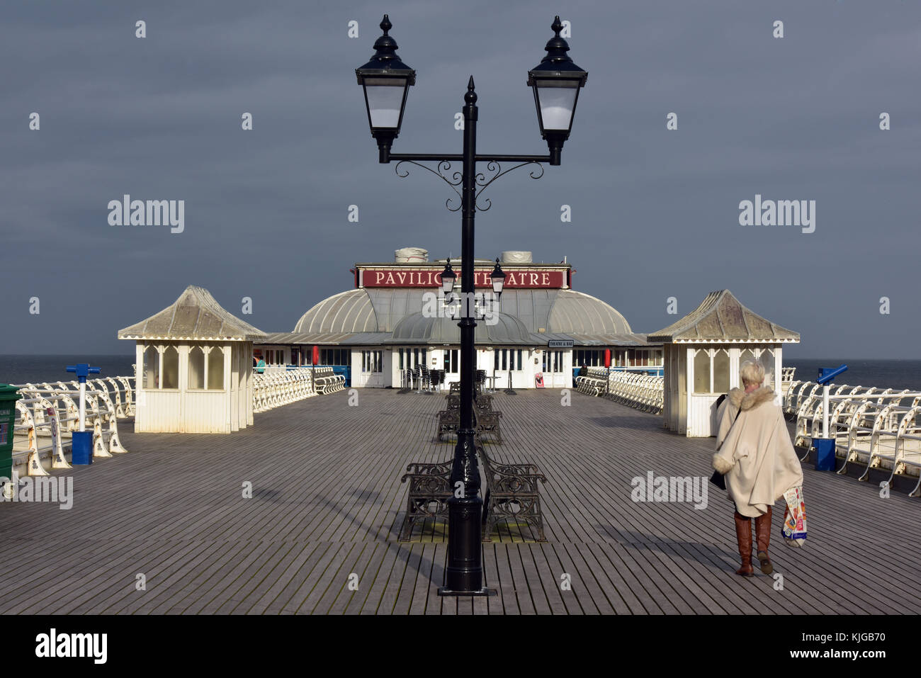 Cromer pier in Norfolk. Edwardian or Victorian seaside structures with lampposts in the foreground. Typically British - Stock Image