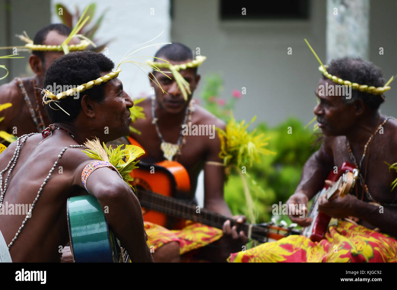 Islanders signing and playing instruments on Papua New Guinea - Stock Image