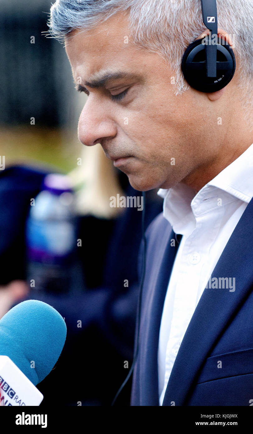 Sadiq Khan (Mayor of London, former Labour MP) giving a radio interviewon College Green, Westminster, discussing - Stock Image