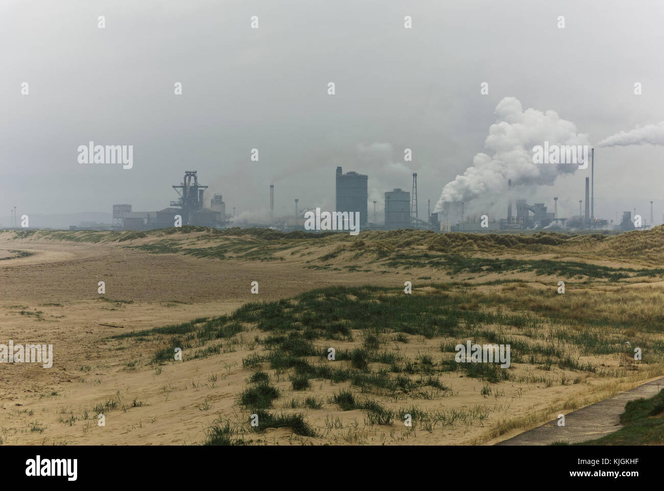 Looking to Redcar steel works from the sand dunes at South Gare in Redcar in Cleveland, North East England, at the - Stock Image