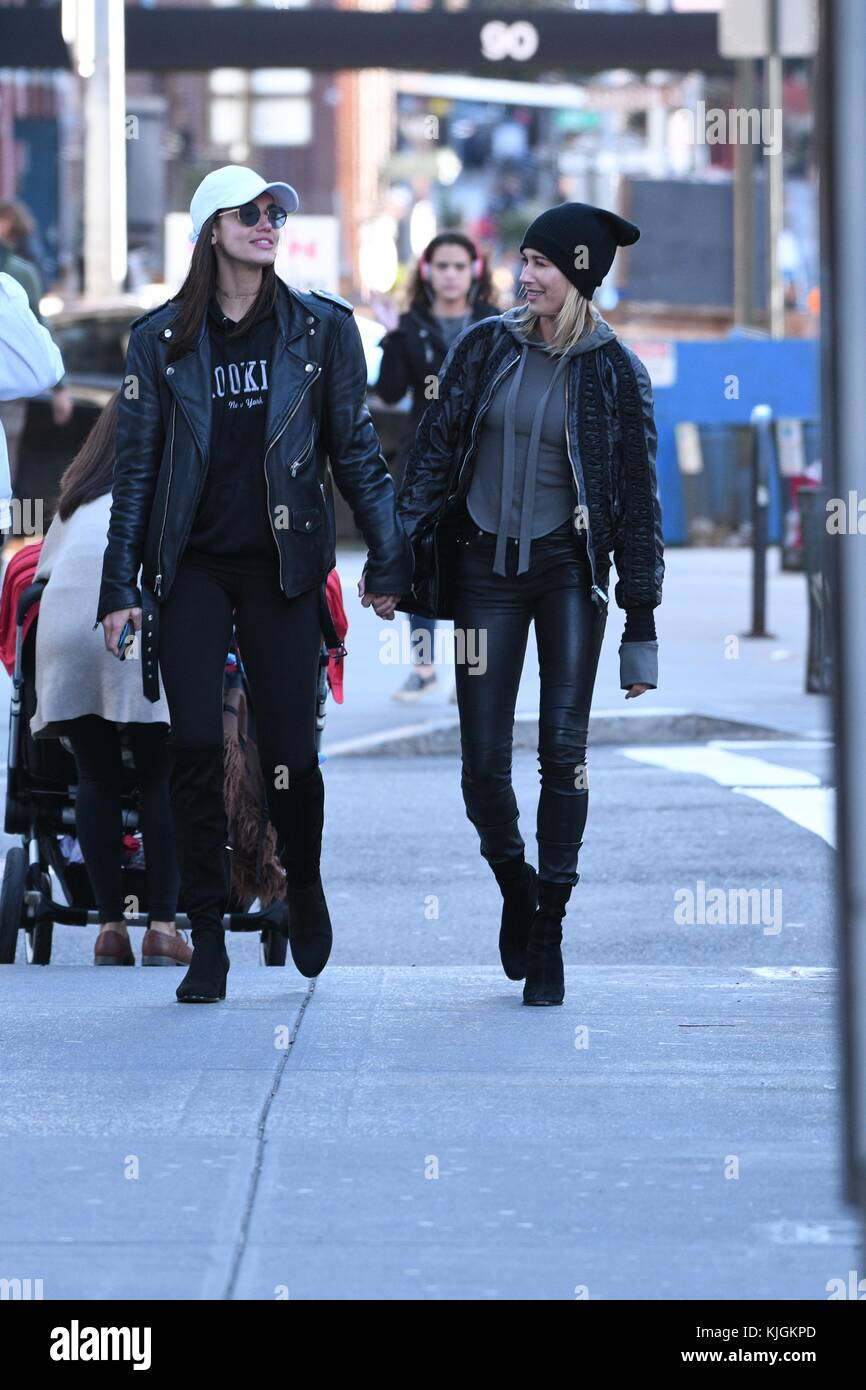 NEW YORK, NY - SEPTEMBER 06: Model Hailey Baldwin walks holding hands with friends in Soho on October 24, 2016 in Stock Photo