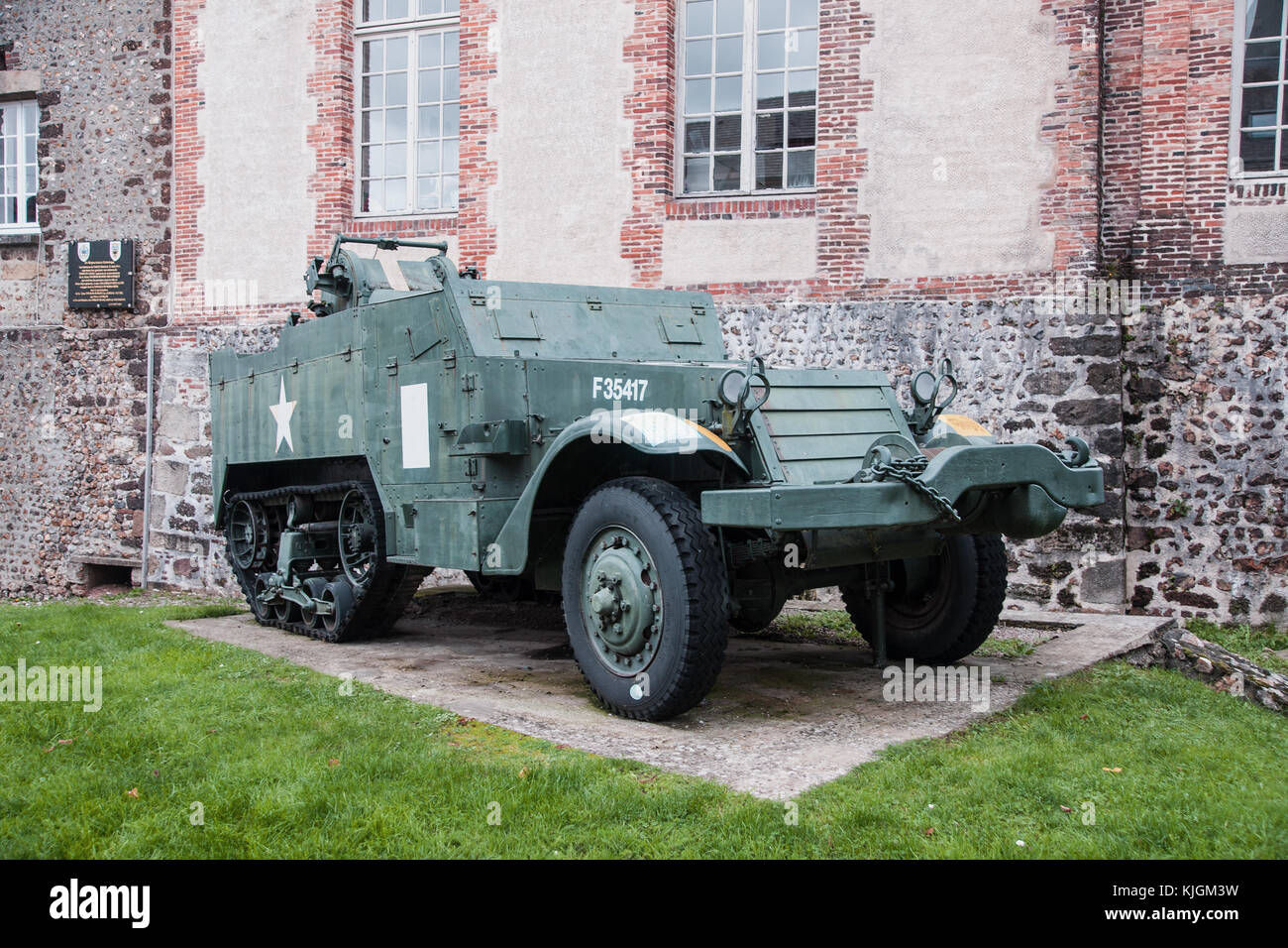 American M3 half-track preserved in L'Aigle, Normandy, to commemorate the town's liberation in 1944 by the - Stock Image