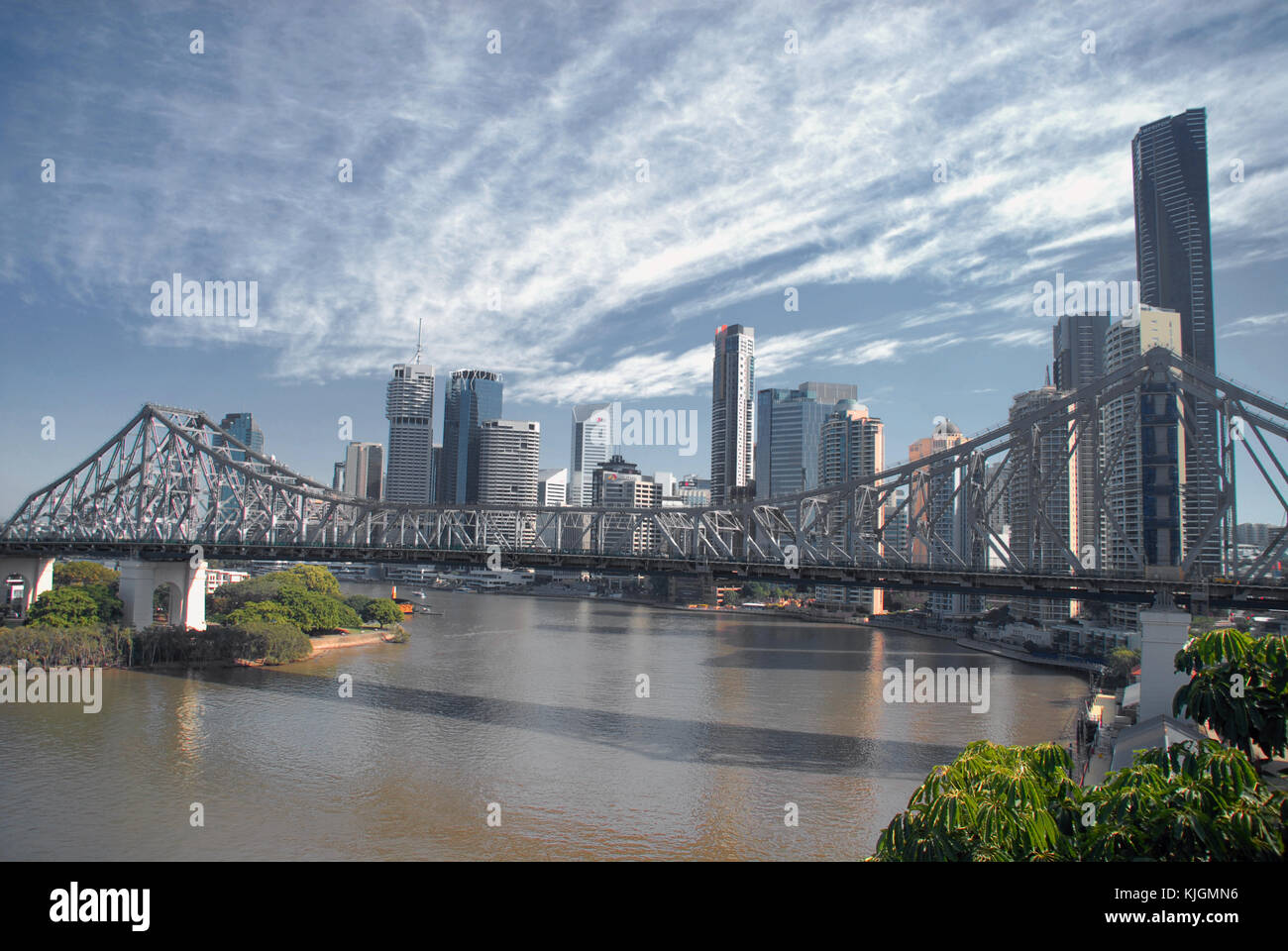 Story Bridge and skyscraper of Brisbane under blue skys with clouds - Stock Image